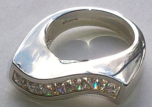 Silver Curved 7 CZ Stone set Ring