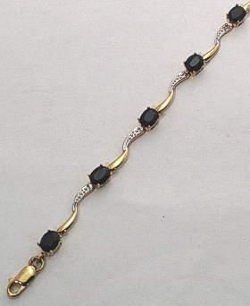 9 carat Gold Sapphire & Diamonds Wave Bracelet