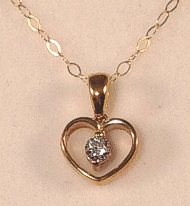 9 carat Gold Open Heart Pendant set with CZ